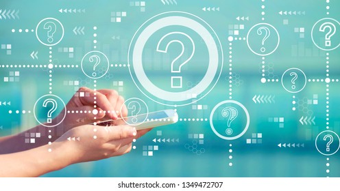 Question marks with person holding a white smartphone