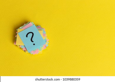 question marks written reminders tickets on yellow paper background.
