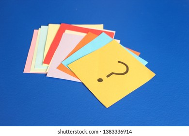 question marks written reminders tickets on background
