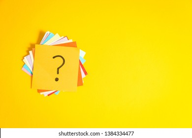 Question marks written reminders tickets on yellow paper background