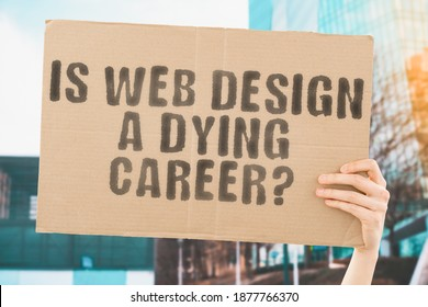 "The question "" Is Web Design a dying career? "" on a banner in men's hand with blurred background. Graphic designer. Job. Profession. Occupation. Work. Position. Earnings"