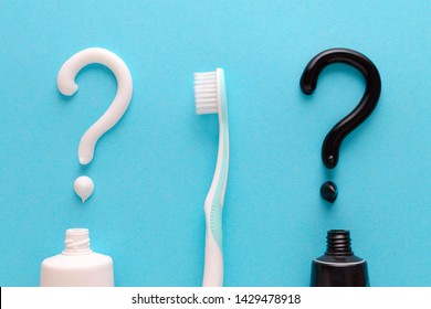 question from white and black toothpaste, teeth care concept, toothbrush on blue background
