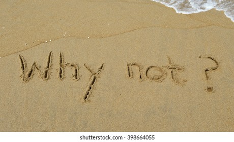 The question Why not? Written in the sand at the beach