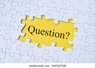 question word on jigsaw puzzle with yellow background. questions, faq, q&a, business concept