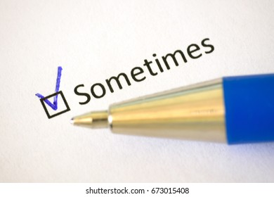 Questionnaire - blue pen and the inscription SOMETIMES with check mark on the white paper