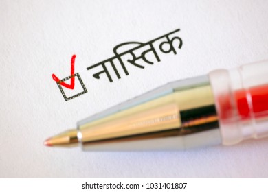 Questionnaire. Red pen and the inscription ATHEIST with check mark on the white paper