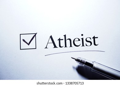 Questionnaire, survey. Checked box with inscription Atheist and black pen.