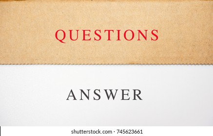 QUESTIONS & ANSWER texts on brown and white paper.