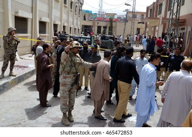 QUETTA, PAKISTAN - AUG 08: Security officials cordon off venue after a powerful bomb blast to investigate and for collection of evidence, nearby Civil Hospital emergency on August 08, 2016 in Quetta.