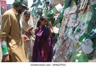QUETTA, PAKISTAN - AUG 11: Pakistan flags and buntings are being selling on roadside stall in connection of Independence Day celebration coming ahead, on August 11, 2017 in Quetta.
