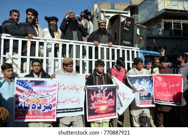 QUETTA, PAKISTAN - DEC 07: Activists of Difa-e-Pakistan Council are holding protest demonstration against US President Donald Trump, outside press club on December 07, 2017 in Quetta.