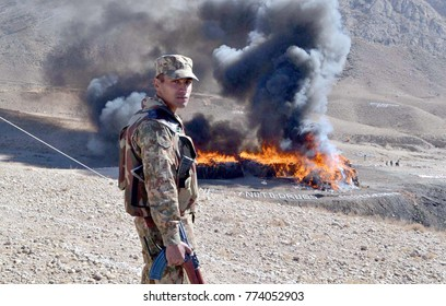 QUETTA, PAKISTAN - DEC 12: View of burning pile of confiscated drugs during the incineration ceremony of seized illegal drugs held at Kuch Mor located on Cantonment area on December 12, 2017 in Quetta