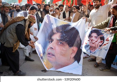 QUETTA, PAKISTAN - DEC 19: Members of ATP burn picture of Federal  Interior Minister Chaudhry Nisar Ali Khan as they are protesting against (NADRA) Department on December 19, 2016  in Quetta.