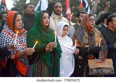 QUETTA, PAKISTAN - DEC 20: Activists of PPP Minority Wing are holding a candle light vigil for the victims of suicide bomb explosion at BMM Church, during protest on December 20, 2017 in Quetta.