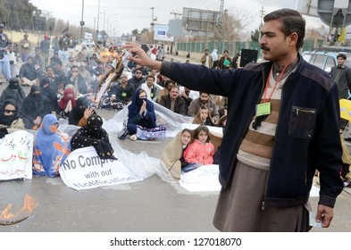 QUETTA, PAKISTAN - FEB 04: A member of Huqooq-e-Teachers Association Balochistan  burn his documents during protest demonstration for regularization on their jobs, on February 04, 2013 in Quetta.