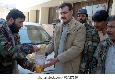 QUETTA, PAKISTAN, JAN 09: Customs officials inspect seized packs of drug (heroine) which were recovered from a vehicle, during press conference in Quetta on Monday, January 09, 2012.