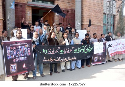 QUETTA, PAKISTAN - JAN 20: Members of BUJ chant slogans against killing of journalists belong to print and electronic media both and demanding for arresting on January 20, 2014.