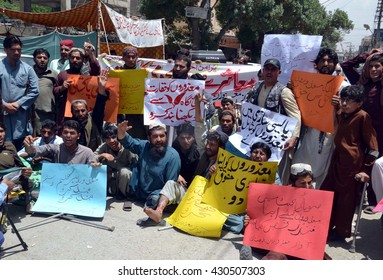 QUETTA, PAKISTAN - JUN 02: Disable persons are protesting against high handedness of police during demonstration outside on June 02, 2016 in Quetta.