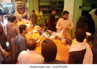 QUETTA, PAKISTAN - JUN 14: Peoples buying Nimco items for Eid-ul-Fitar as going back to their villages to spend Eid holidays with their families, on June 14, 2018 in Quetta.