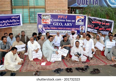 QUETTA, PAKISTAN - JUN 30: Members of Balochistan Union of Journalists (BUJ) chant  slogans against closure of private T.V channels during protest demonstration on June 30, 2014 in Quetta.