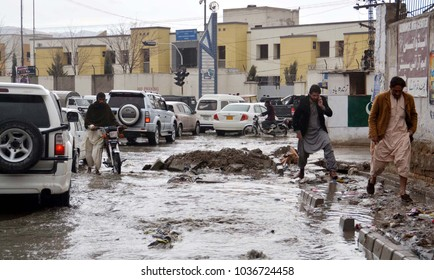 QUETTA, PAKISTAN - MAR 01: Inundated road by overflowing sewerage water creating problems for commuters, showing negligence of concerned authorities, on March 01, 2018 in Quetta.