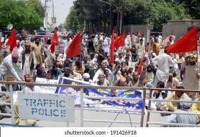 QUETTA, PAKISTAN - MAY 07: Members of Water and Sanitation Authority (WASA)  Employees Union chant slogans against non-payments of their dues salaries during protest on May 07, 2014 in Quetta.