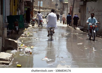 QUETTA, PAKISTAN - MAY 08: Inundated road by overflowing sewerage water creating problems for commuters, showing negligence of concerned authorities, at Alamdar road on May 08, 2018 in Quetta.
