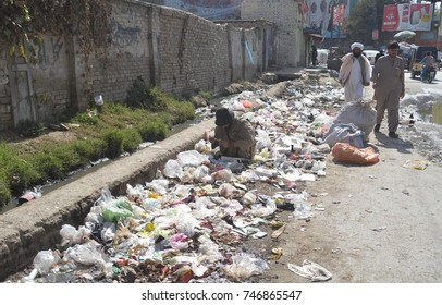 QUETTA, PAKISTAN - NOV 01: Heap of garbage at a roadside in Quetta showing negligence of concerned authorities, on November 01, 2017 in Quetta.
