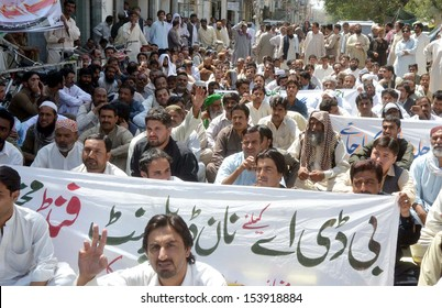 QUETTA, PAKISTAN - SEP 12: Employees of (BDA) chant slogans for allocate non-development fund during protest demonstration arranged by All Pakistan Clerk Association on September 12, 2013 in Quetta.