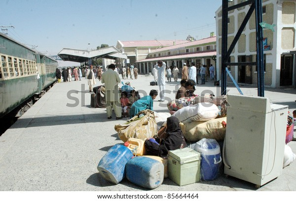 QUETTA, PAKISTAN - SEPT 29: Passengers gather at platform as they are waiting of trains which are still late from their original schedules at Quetta railway station on September 29, 2011in Quetta.