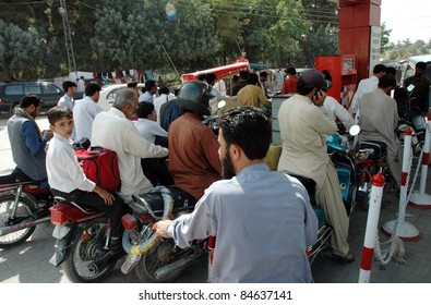 QUETTA, PAKISTAN - SEPTEMBER 13: A large number of motorists gather at a fuel station to get petrol as they are facing shortage of petrol in city, in Quetta September 13, 2011.