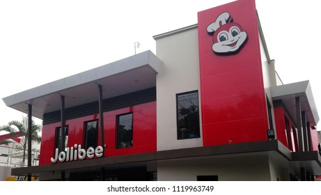 QUEZON CITY, PH - JUNE 23: Jollibee fast food facade on June 23, 2018 in Banawe, Quezon City, Philippines. Jollibee brand name is a fast food chain restaurant in the Philippines.