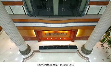 QUEZON CITY, PH - JUNE 23: Sanctuarium signage and atrium area on June 23, 2018 in Quezon City, Philippines. Sanctuarium company is a columbarium and cremation place located in the Philippines.