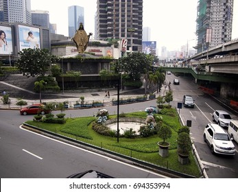 QUEZON CITY, PHILIPPINES - AUGUST 8, 2017: Vehicles pass by the Edsa Shrine.