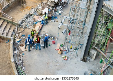 Quezon City / Philippines - February 15, 2019: construction workers taking a break and discussing their plan for the day