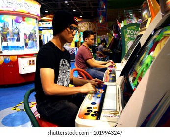 QUEZON CITY, PHILIPPINES - JANUARY 14, 2018: Customers enjoy the different games and attractions inside an amusement arcade inside a shopping mall.