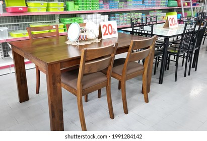 Quezon City, Philippines - June 2021: The photo shows a wooden dining set with table and chairs displayed on a furniture shop and house wares store.