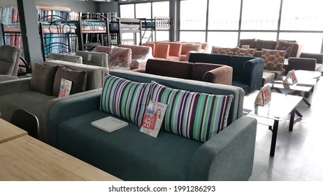 Quezon City, Philippines - June 2021: The photo shows a selection of sofa and sofa bed displayed on a furniture shop on Metro Manila.