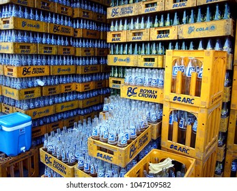 QUEZON CITY, PHILIPPINES - MARCH 9, 2018: Stacks of soda drink bottles in front of a local store.