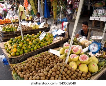 QUEZON CITY, PHILIPPINES - NOVEMBER 22, 2015: Street vendors sell a variety of fresh fruits.