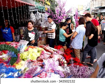 QUEZON CITY, PHILIPPINES - NOVEMBER 22, 2015: Customers look at a wide variety of chirstmas decors at a store in Dapitan Market. Dapitan Market is known for its wide variety of home decor products.