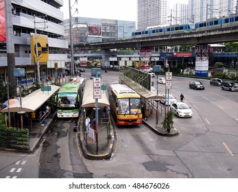 QUEZON CITY, PHILIPPINES - SEPTEMBER 13, 2016: Public and private transportation vehicles along EDSA. A major hiway in Metro Manila.