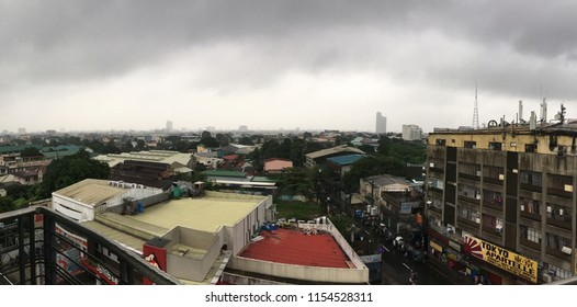 QUEZON CITY, PHILIPPINES-AUGUST 12, 2018: Dark clouds hover over the metropolis as the monsoon season brings torrential rains and floods to many of its low-lying areas.