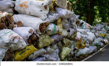 Quezon, Philippines - March 13, 2019: Piles of coconut in sack for sale along the road in Real, Quezon, Philippines.