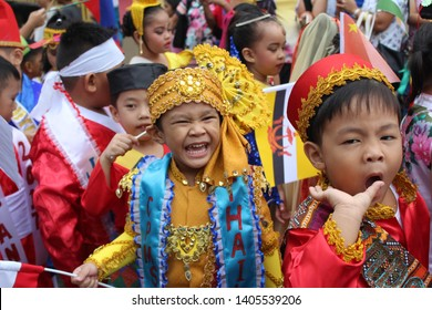 Quezon Province, Philippines - October 24, 2017: Annual celebration of United Nation Day where children represents the traditional costume of different countries. Main focus: Mr. Thailand & Vietnam.
