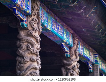 Qufu / China - October 13th 2018: Coiled dragon pillars in front of Dacheng Hall, Temple of Confucius, a UNESCO World Heritage Site in Qufu, birthplace of Confucius.