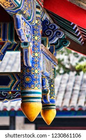 Qufu / China - October 13th 2018: Traditional Chinese architectural roof beam decorations at the Temple of Confucius complex, a UNESCO world heritage site in Qufu, China