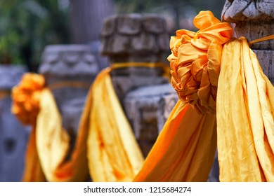 Qufu, Shandong Province / China - October 13th 2018: Yellow silk scarves decorating the marble pillars at the Temple of Confucius, a UNESCO World Heritage Site in Qufu, birthplace of Confucius.