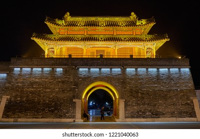 Qufu, Shandong Province / China - October 13th 2018: Qufu Drum tower at night. Qufu is famous as the birthplace of philosopher Confucius.