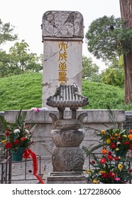 Qufu, Shandong Province / China - October 13th 2018: The Tomb of Confucius, part of the UNESCO World Heritage Site Temple and Cemetery of Confucius in Qufu, birthplace of Confucius.